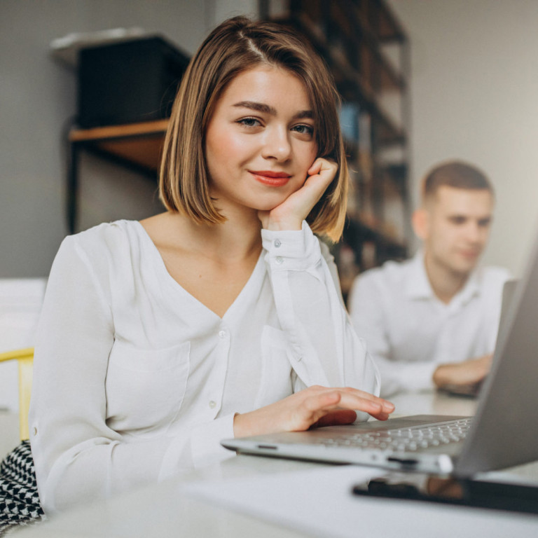 Female and male collegues working in office